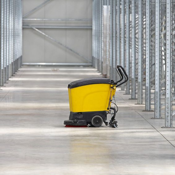 45380692 - walk behind scrubber machine for cleaning warehouse floor
